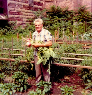 Grandpa in his garden behind the fish market.